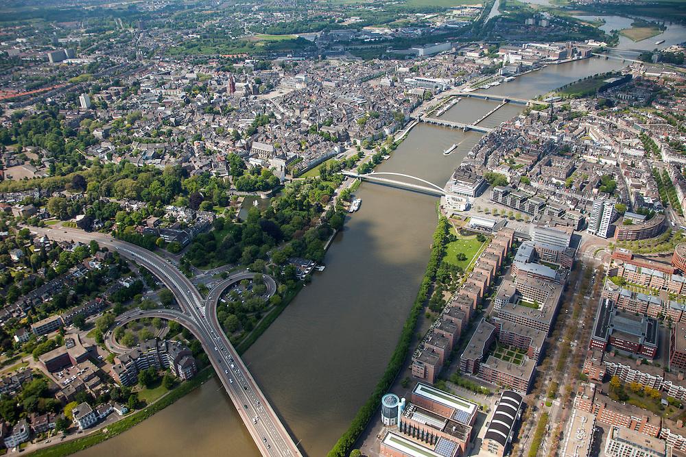 Nederland, Limburg, Gemeente Maastricht, 27-05-2013; <br /> Overzicht over de historische binnenstad met de rode toren van de Sint Janskerk op het Vrijhof en bruggen over de rivier, beneden in beeld de verkeersbrug John F. Kennedybrug (N278) over de rivier de Maas, de Hoge Brug, de Sint Servaasbrug, de Wilhelminabrug, een spoorbrug en als laatste de Noorderbrug  Op de rechteroever de nieuwe wijk Ceramique en het Bonnefantenmuseum.<br /> View on the old town of Maastricht on the left bank and the bridges  on the river Maar (Meuse).<br /> Bottom pic the John F. Kennedy Bridge (N278). On the right bank the new constructuted district Ceramique with the Bonnefantenmuseum.<br /> luchtfoto (toeslag op standaardtarieven);<br /> aerial photo (additional fee required);<br /> copyright foto/photo Siebe Swart.