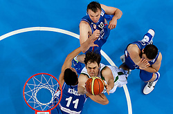 Erazem Lorbek of Slovenia between Marko Keselj of Serbia, Dusko Savanovic of Serbia and Kosta Perovic of Serbia during basketball game between National basketball teams of Slovenia and Serbia in 7th place game of FIBA Europe Eurobasket Lithuania 2011, on September 17, 2011, in Arena Zalgirio, Kaunas, Lithuania. Slovenia defeated Serbia 72 - 68 and placed 7th. (Photo by Vid Ponikvar / Sportida)