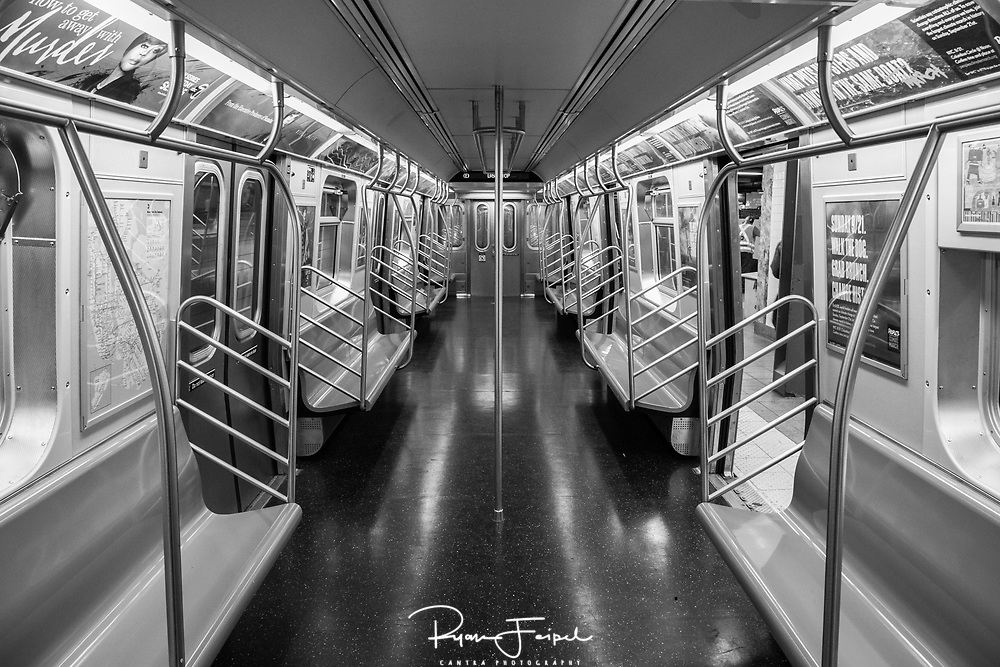 It's not often you find a whole subway car to yourself in New York City.  Yet, after a long night shooting the city life it was time to go home.  I was about to leave the station when I noticed the absence of everything.  Luckily I still had the camera at the ready for one last shot.
