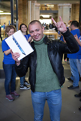 The new iPad Air on sale in London. <br /> Constantin Zabrotskiy, Living in Moscow, the first in getting the iPad Air gets cheered by Apple employees at Covent Garden's Apple store, London, United Kingdom. Friday, 1st November 2013. Picture by Daniel Leal-Olivas / i-Images