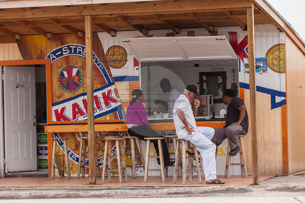 Local residents at a roadside food stall at Potter's Cay in Nassau, Bahamas.
