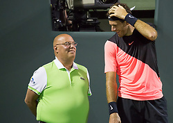 March 28, 2018 - Key Biscayne, Florida, United States - Juan Martin Del Potro, from Argentina, jokes with a lineman during his quarter final match at the Miami Open. Del Potro defeated Raonic 5-7, 7-6(1), 7-6(3) in Miami, on March 28, 2018. (Credit Image: © Manuel Mazzanti/NurPhoto via ZUMA Press)