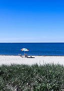 Beach umbrella and chairs, West Dennis Beach, Cape Cod, Massachusetts, USA.