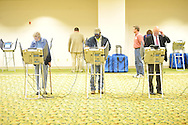 Voters cast their ballots at the Oxford Conference Center in Oxford, Miss. on Tuesday, November 6, 2012. (AP Photo/Oxford Eagle, Bruce Newman)