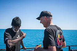 Ex Federal Senator Bob Brown chats to Goolarabooloo traditional owner Richard Hunter on board Sea Shepherd's The Steve Irwin off James Price Point during Operation Kimberley Miinimbi in August 2012.