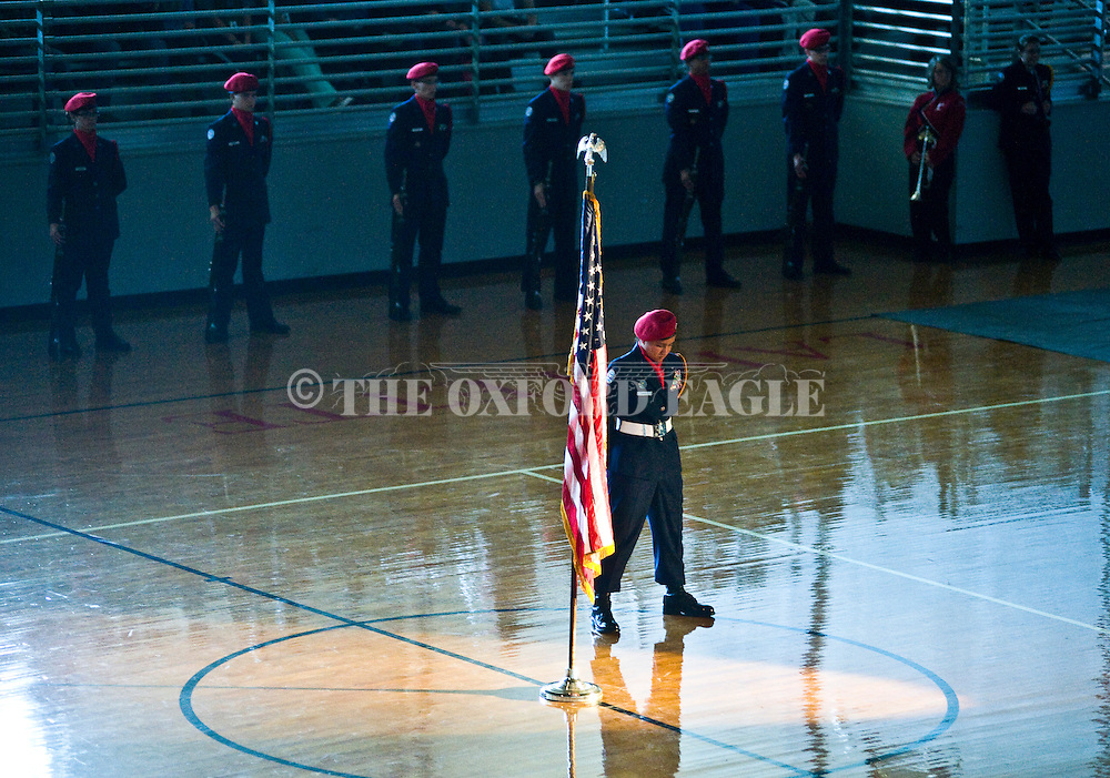 AFJROTC Cadet Courtney Conway presents the colors at a Veterans Day program at Lafayette High School in Oxford, Miss. on Thursday, November 7, 2013.
