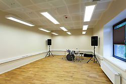 Practice room in H. Eller music school in Tartu, Estonia. Empty classroom with drums and loudspeakers.
