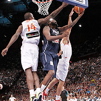 15 July 2012: Ronny Turiaf of Team France goes for the layup against Serge Ibaka and Victor Sada during a pre-Olympic exhibition game won 75-70 by Spain over France, at the Palais Omnisports de Paris Bercy, in Paris, France.