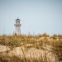 Photo of New Buffalo  lighthouse with beach sand grass in New Buffalo Michigan.