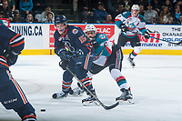 KELOWNA, CANADA - MARCH 25: Devante Stephens #21 of the Kelowna Rockets back checks Collin Shirley #15 of the Kamloops Blazers during second period on March 25, 2017 at Prospera Place in Kelowna, British Columbia, Canada.  (Photo by Marissa Baecker/Shoot the Breeze)  *** Local Caption ***