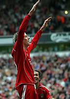 Photo: Paul Thomas.<br /> Liverpool v West Ham United. The Barclays Premiership. 26/08/2006.<br /> <br /> Peter Crouch (L) celebrates his goal for Liverpool with Luis Garcia.
