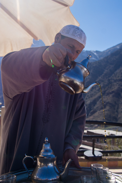 At the Atlas Mountains in Morocco being welcomed meant that you would have the local herbal tea.  This image is of a man whose home we visited. I took this image of him while pouring me a hot cup of tea, which I thoroughly enjoyed.