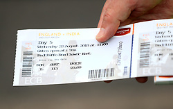 Fan holds a ticket showing free entry after Nottinghamshire County Cricket Club said they would refund fans that have paid during day five of the Specsavers Third Test match at Trent Bridge, Nottingham.