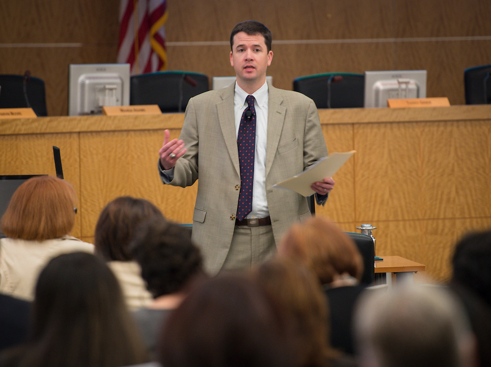 Dr. Andrew Houlihan comments during a principal meeting, April 9, 2014.