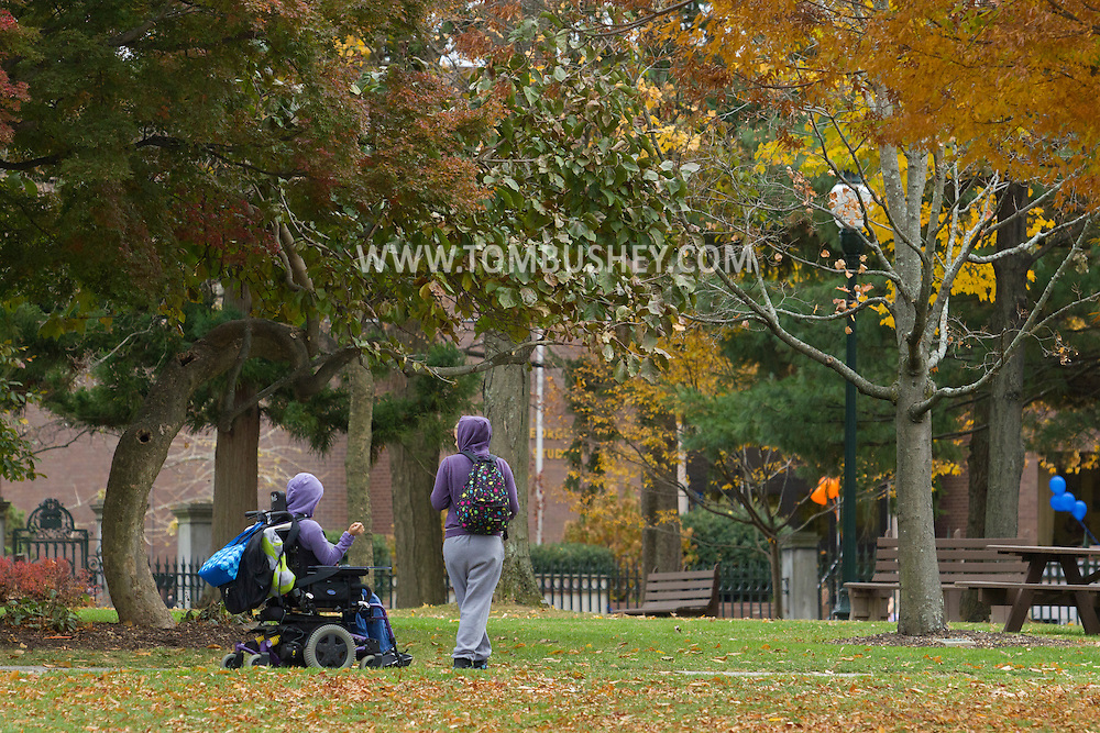 Middletown, New York  - Two students, including one in a motorized wheelchar, move through the Middletown campus of SUNY Orange on  Nov. 6, 2013.