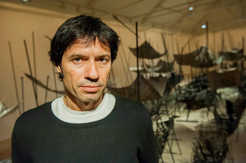 "Departure, the first UK solo exhibition of artist Xavier Mascaró (pictured). Highlights include: Departure (pictured) an installation of boats made from bronze and iron ""which are evocative of long-forgotten shipwrecks""; iron portraits of a young woman from the Eleonora series ""reminiscent of the profiles on ancient coins""; delicate metal works ""resembling votive figures from his Idols series""; and his Guardians series, of 10 feet high rusted iron warriors ""inspired by medieval armour and ancient Egyptian and Greek art"".  The latter being the first outdoor installation by the Gallery since moving to Chelsea. The show runs from 3 September until 5th October at The Saatchi Gallery, Chelsea, London. 01 September 2014."