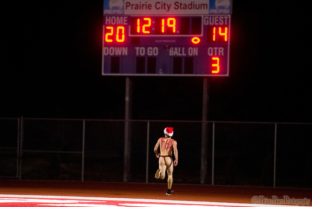 A streakers runs to the end zone during halftime as the Folsom High School Bulldogs varsity football team hosts the Central High School Grizzlies in the CIF NorCal Division I-AA title game, Friday Dec 8, 2017. The winner of this game will face the CIF SoCal winner in the State Championship game at Sacramento State, Friday Dec 15th.<br /> photo by Brian Baer