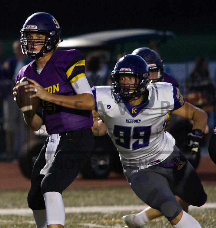 Kearney's Daniel Piburn rushes in to sack Belton quarterback Bart Harris on Friday at Southwick Stadium. Kearney's defense gave Belton fits in the Bulldogs' 44-7 win.