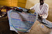 A man making handbags at the Village Artisanal de Ouagadougou, a cooperative that employs dozens of artisans who work in different mediums, in Ouagadougou, Burkina Faso, on Monday November 3, 2008.