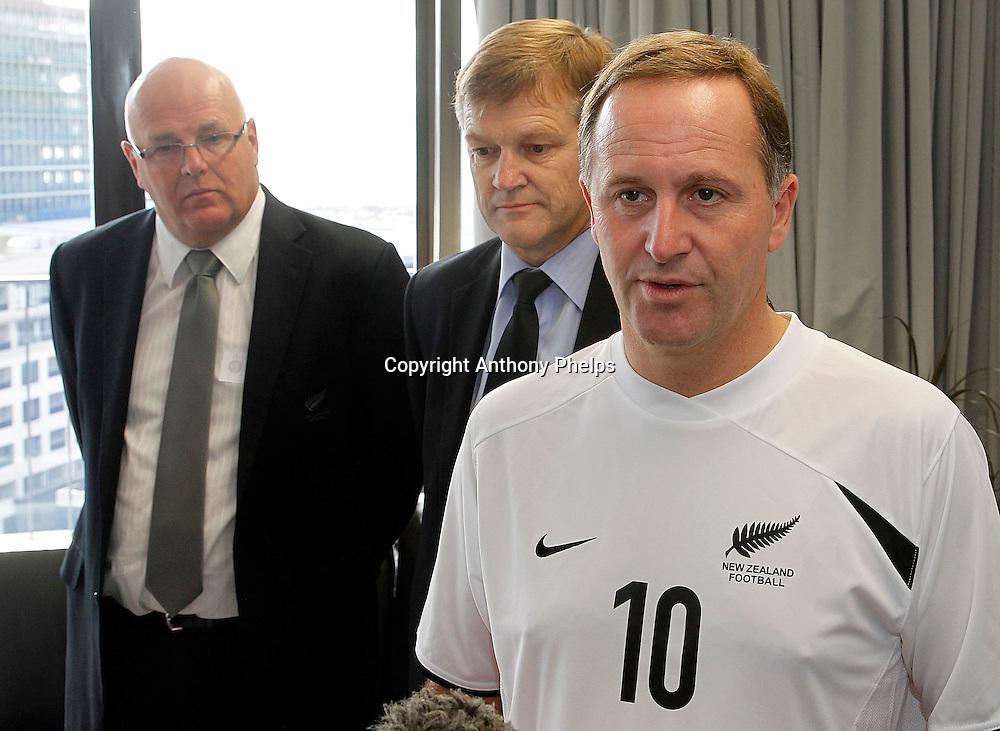 Prime Minister John Key is presented with a jersey and scarf as he is made Patron of the All Whites for the 2010 FIFA World Cup campaign, 31 March, 2010 by Chairman Frank van Hattum and CEO Michael Glading  Photo : Anthony Phelps/PHOTOSPORT