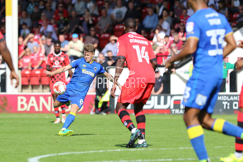 AFC Wimbledon midfielder Jake Reeves (8) strike on goal during the EFL Sky Bet League 1 match between Walsall and AFC Wimbledon at the Banks's Stadium, Walsall, England on 6 August 2016. Photo by Stuart Butcher.
