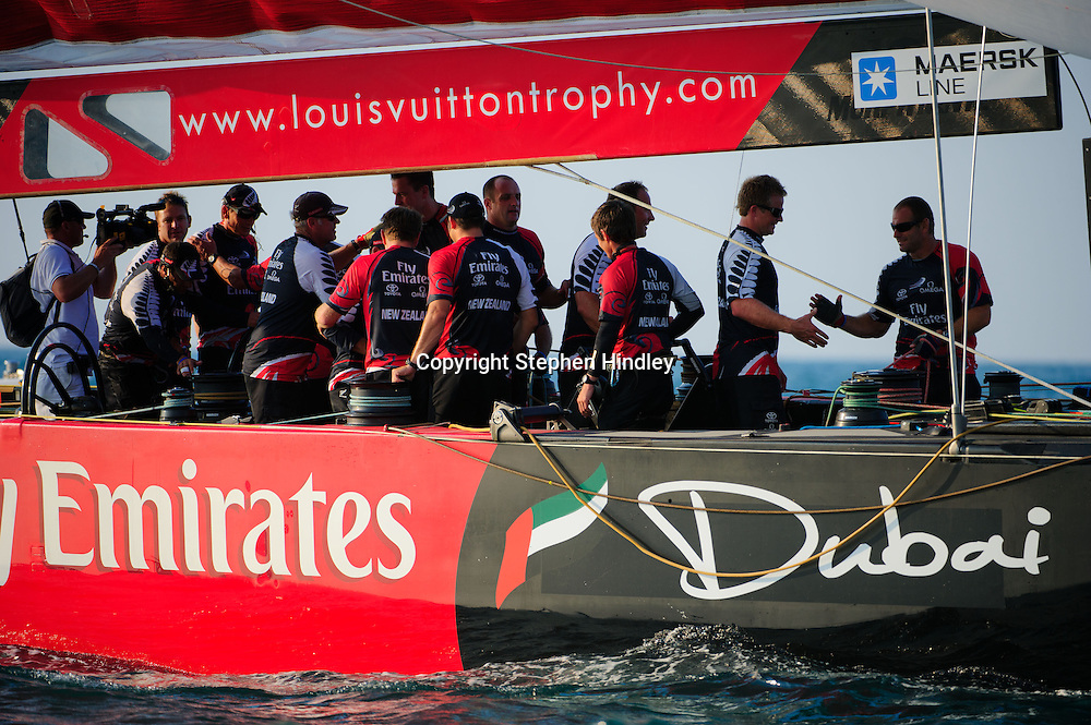 The Emirates Team New Zealand crew congratulate each other after winning the final of the Louis Vuitton Trophy held at the Dubai International Marine Club on Saturday, November 27th, 2010. Photo by: Stephen Hindley/SPORTDXB
