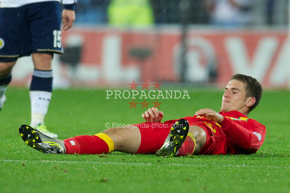 CARDIFF, WALES - Friday, October 12, 2012: Wales' Aaron Ramsey looks dejected after being booked for a tackle and misses the next game during the Brazil 2014 FIFA World Cup Qualifying Group A match against Scotland at the Cardiff City Stadium. (Pic by David Rawcliffe/Propaganda)