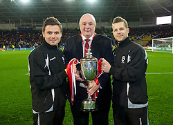CARDIFF, WALES - Friday, October 12, 2012: Football Association of Wales' President Trevor Lloyd-Hughes with xxxx cup winners xxxx during half-time at the Brazil 2014 FIFA World Cup Qualifying Group A match against Scotland at the Cardiff City Stadium. (Pic by David Rawcliffe/Propaganda)