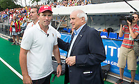 ANTWERP -   Disappointed Jeroen Delmee (l) , coach of  Belgium  with Leandro Negre, president FIH,  after the final Australia vs Belgium (1-0). left  WSP COPYRIGHT KOEN SUYK