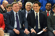 © Licensed to London News Pictures. 14/02/2013. Bedford, UK. Ed Balls (L) and Ed Miliband sit before the speech. Ed Miliband MP, Leader of the Labour Party, delivers a major speech at Bedford Training Group in Bedford today, 14th February 2013. In the speech he set out a 'One Nation Labour agenda for rebuilding Britain's economy'. The speech was followed by a Q&A session with Ed Balls, Shadow Chancellor and a tour of the training facility. Photo credit : Stephen Simpson/LNP