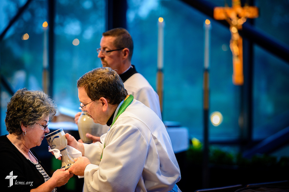 The Rev. Herb Mueller, LCMS first vice-president, distributes the sacrament at worship during floor-committee weekend at the International Center of The Lutheran Church–Missouri Synod on Saturday, May 28, 2016, in Kirkwood, Mo. LCMS Communications/Erik M. Lunsford