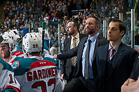 KELOWNA, CANADA - APRIL 14: Kelowna Rockets' assistant coach Kris Mallette, head coach Jason Smith and assistant coach Travis Crickard stand on the bench against the Portland Winterhawks on April 14, 2017 at Prospera Place in Kelowna, British Columbia, Canada.  (Photo by Marissa Baecker/Shoot the Breeze)  *** Local Caption ***