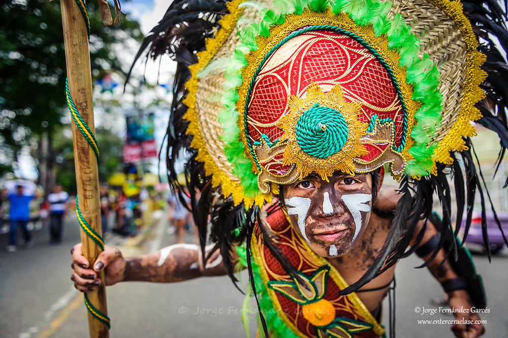 """Participants of the parade during the celebration of Dinagyang in homage to """"The Santo Niño"""", the patron saint of many Philippino cities. Iloilo, Philippines"""