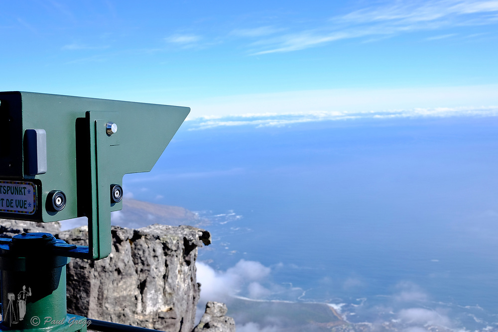 Table Mountain,Cape Town, South Africa. A telescope mounted on the viewing platform overlooking Camps Bay.