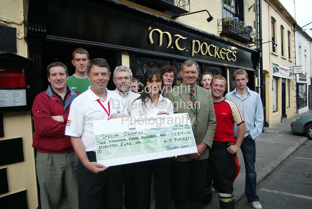 Presentation of cheque on behalf of patrons of M T Pockets Thomastown to.Thomastown Special Olympics Host Town Committee.  2317 Euro was raised from.a soccer game between pub patrons and local Garda team and a sponsored leg.wax...Pictured Left to Right:  Kevin Kelly(Secretary Thomastown HT committee),.Keith Lannon, Seamus Reade(Chairman Thomastown HT comm.), John.Quinn(Committee), Hughie Mullins, Deirdre Carroll(M T Pockets), Kay.Cody(Committee), Superintendent Aidan Roche(Committee), Brendan Heafey,.Damien Dunne and John Furlong...Thomastownb hosts a Special Olympics Basketball team all this week prior to.their involvement in the games next week in Dublin.