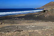 Waves black sand beach Playa la Solapa,  near Paraja, Fuerteventura, Canary Islands, Spain