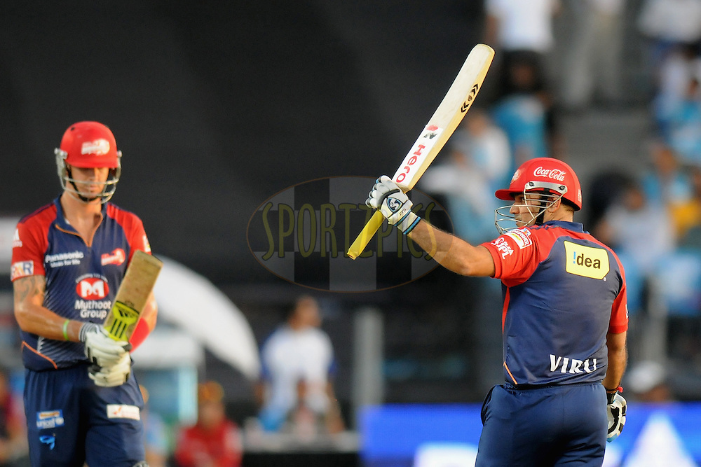 Virender Sehwag captain of Delhi Daredevils celebrates after scoring a half century during match 31 of the Indian Premier League ( IPL) 2012  between The Pune Warriors India and the Delhi Daredevils held at the Subrata Roy Sahara Stadium, Pune on the 24th April 2012..Photo by Pal Pillai/IPL/SPORTZPICS