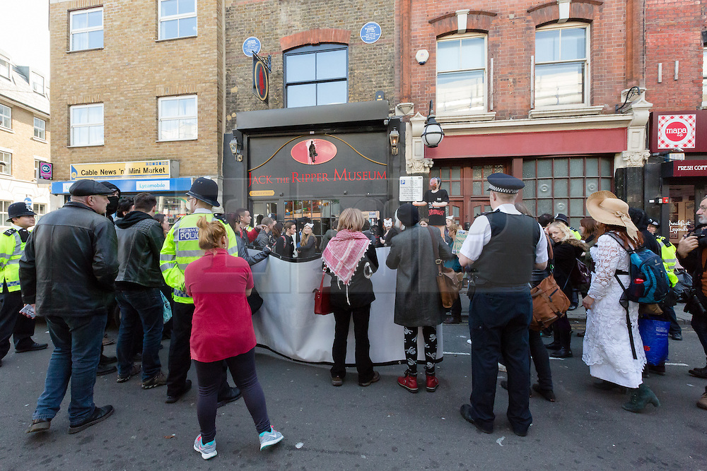 "© Licensed to London News Pictures. 31/10/2015. London, UK. Demonstrators protest with a blow up doll of museum owner, Mark Palmer-Edgecumbe outside the Jack the Ripper Museum in Cable Street, Shadwell, east London. The protest is organised by feminist group, The Fourth Wave and attended by Class War and other activists, who are protesting against a Halloween event being held at the museum this weekend, where visitors can take selfie photographs inside the museum with ""Jack the Ripper"" and some of his female victims played by actors. Photo credit : Vickie Flores/LNP"