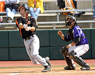 Kansas State catcher Brandon Farr (R) watches the ball sail into the sky, after Oklahoma State's Shelby Ford (L) hammers a grand slam in the top of the tenth inning.  Oklahoma State defeated K-State 9-4 in 10 innings at Tointon Stadium in Manhattan, Kansas, April 30, 2006.