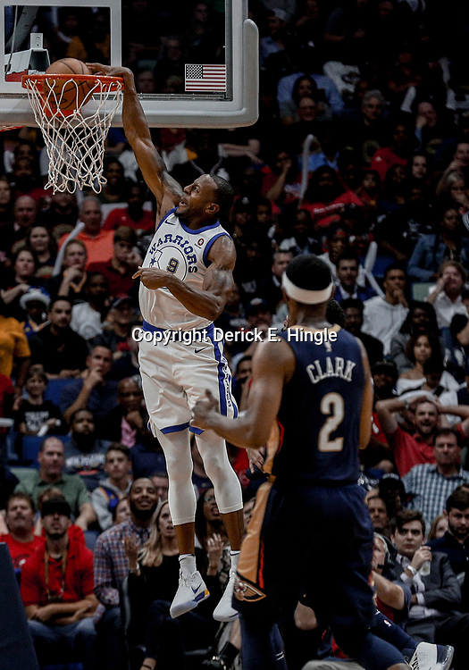 Oct 20, 2017; New Orleans, LA, USA; Golden State Warriors forward Andre Iguodala (9) dunks over New Orleans Pelicans guard Ian Clark (2) during the second half of a game at the Smoothie King Center. The Warriors defeated the Pelicans 128-120.  Mandatory Credit: Derick E. Hingle-USA TODAY Sports