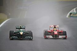 O piloto brasileiro Felipe Massa (D) acelera sua Ferrari  durante a primeira volta do Grande Prémio do Brasil de Fórmula 1, em Interlagos, São Paulo. FOTO: Jefferson Bernardes/Preview.com