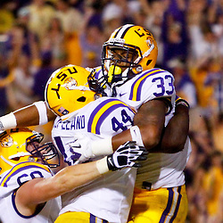 November 3, 2012; Baton Rouge, LA, USA;  LSU Tigers running back Jeremy Hill (33) celebrates a touchdown with teammates during a game against the Alabama Crimson Tide at Tiger Stadium. Alabama defeated LSU 21-17. Mandatory Credit: Derick E. Hingle-US PRESSWIRE