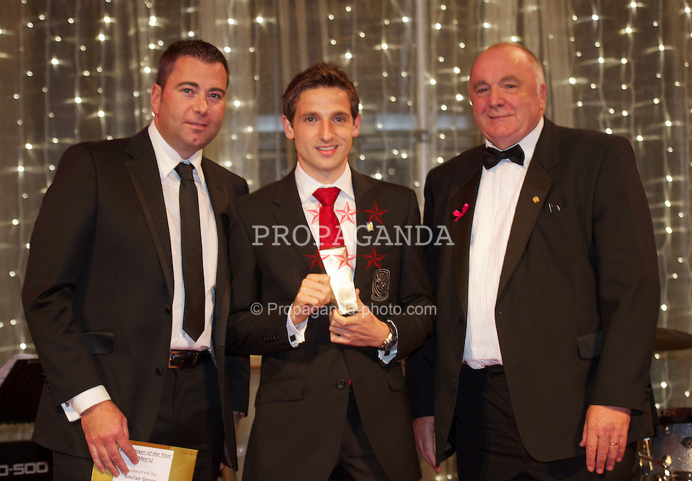 CARDIFF, WALES - Monday, October 8, 2012: Wales' Joe Allen receives the Club Player of the Year award from FAW President Trevor Lloyd-Hughes and Sinclair Group's Jonathan Sinclair during the FAW Player of the Year Awards Dinner at the National Museum Cardiff. (Pic by David Rawcliffe/Propaganda)