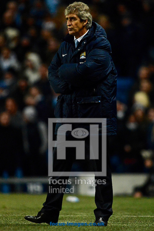 Picture by Ian Wadkins/Focus Images Ltd +44 7877 568959<br /> 26/12/2013<br /> Manchester City manager Manuel Pellegrini during the Barclays Premier League match at the Etihad Stadium, Manchester.