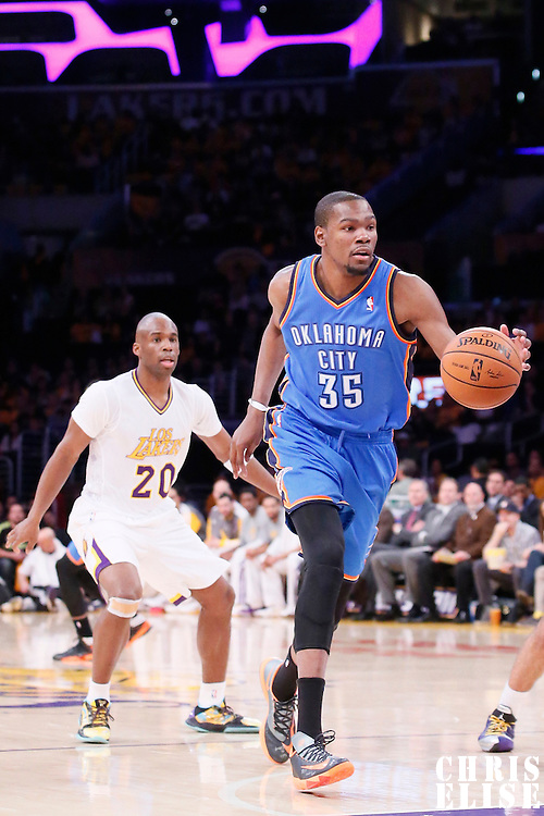 09 March 2014: Oklahoma City Thunder small forward Kevin Durant (35) drives past Los Angeles Lakers shooting guard Jodie Meeks (20) during the Los Angeles Lakers 114-110 victory over the Oklahoma City Thunder at the Staples Center, Los Angeles, California, USA.