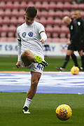 Leeds United midfielder Jamie Shackleton (46) warming up during the EFL Sky Bet Championship match between Wigan Athletic and Leeds United at the DW Stadium, Wigan, England on 4 November 2018.