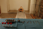 """GEORGES LABIT MUSEUM, TOULOUSE, FRANCE - MARCH 03 - EXCLUSIVE : A general view of the surgery tools with the Egyptian mummy in the background on March 3, 2009 in the Georges Labit Museum, Toulouse, France. The Egyptian mummy arrived in Toulouse in 1849, encased in a sarcophagus labelled """"In-Imen"""" from the 7th or 8th century BC. It is preserved at the Labit Museum since 1949. The mummy is now the subject of a very rare tissue sampling operation to determine its datation.  (Photo by Manuel Cohen)"""