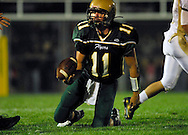 11 SEPT. 2009 -- ST. LOUIS -- Lindbergh High School quarterback Kyle Portell (11) hand the ball to an official during the Flyers game against Oakville Friday, Sept. 11, 2009. Lindbergh led Oakville 14-0 at halftime on a pair of touchdowns by running back Eric Schwartz. Photo © copyright 2009 by Sid Hastings.