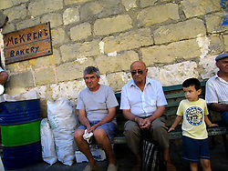 MALTA GOZO NADUR 22JUL06 - Maltese people wait for the bus outside Mekren's Bakery in Nadur, Gozo...jre/Photo by Jiri Rezac..© Jiri Rezac 2006..Contact: +44 (0) 7050 110 417.Mobile:  +44 (0) 7801 337 683.Office:  +44 (0) 20 8968 9635..Email:   jiri@jirirezac.com.Web:    www.jirirezac.com