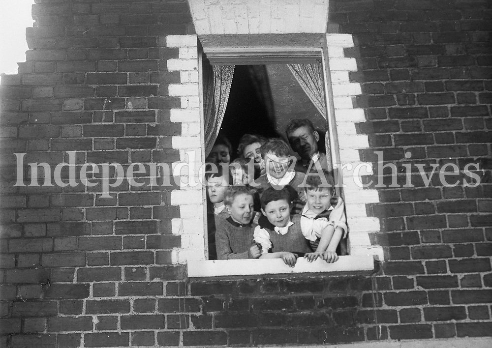 Group of children gathered in a window. Date and location unknown.(Part of the Independent Ireland Newspapers/NLI Colection)